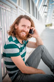Stylish hipster model with long red hair and beard lifestyle on Stock Photo