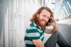 Stylish hipster model with long red hair and beard lifestyle on Stock Photography