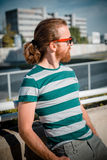 Stylish hipster model with long red hair and beard lifestyle Royalty Free Stock Photos