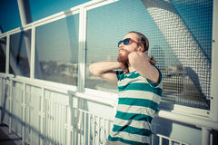 Stylish hipster model with long red hair and beard lifestyle Royalty Free Stock Image