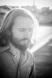 Stylish hipster model with long red hair and beard lifestyle Stock Photography
