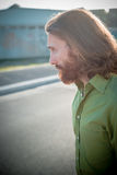 Stylish hipster model with long red hair and beard lifestyle Royalty Free Stock Photo