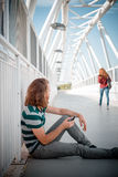 Stylish hipster model with long red hair and beard looking woman Stock Photo