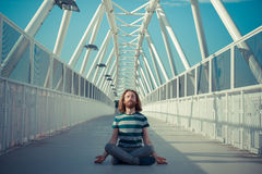Stylish hipster model with long red hair and beard yoga Stock Image
