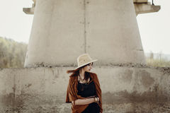 Stylish hipster woman in hat with windy hair posing near river s Stock Images