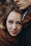 Stylish hipster woman portrait smiling while hugging her man.  t Royalty Free Stock Photo