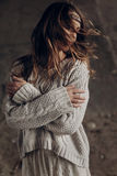 Stylish hipster woman posing in knitted sweater. atmospheric win. Dy sensual moment. boho country fashionable look Royalty Free Stock Photo
