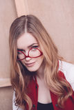 Stylish hipster woman posing with red eyeglasses Royalty Free Stock Photos