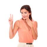 Stylish hispanic lady making a victory sign Stock Images