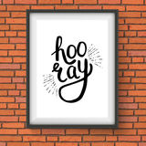 Stylish Hooray Text in a Frame Hanging on Wall Stock Photo