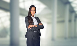 Stylish hostess or businesswoman standing waiting Stock Photography