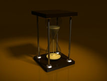 Stylish hourglass in the ray of light Royalty Free Stock Photo