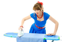 Stylish housewife ironing the clothes Stock Images