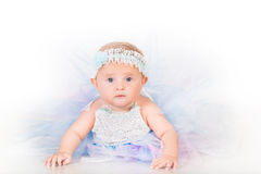 Stylish infancy, babe in lush skirt Stock Photography
