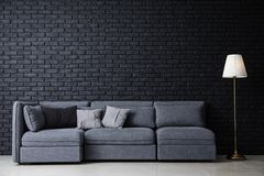 Free Stylish Interior Of Room With Comfortable Big Sofa Near Dark Brick Wall Royalty Free Stock Image - 151369306