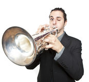 Stylish jazz man playing the trumpet Royalty Free Stock Images