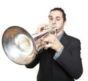 Stylish jazz man playing the trumpet. On white background Royalty Free Stock Images
