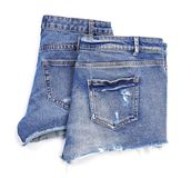 Stylish jean shorts on white background,. Top view royalty free stock photography
