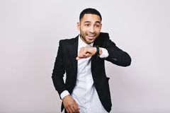 Stylish joyful young handsome man in white shirt, black jacket having fun on white background. Achieve success. Expressing true positive emotions, positivity royalty free stock image