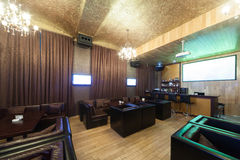 Stylish karaoke bar with leather armchairs Royalty Free Stock Photo
