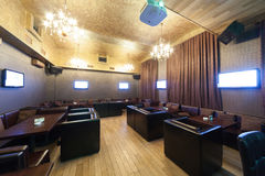 Stylish karaoke bar with leather armchairs Royalty Free Stock Photography