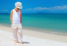 Stylish kid boy walking the tropical beach Royalty Free Stock Photo