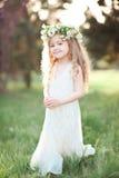 Stylish kid girl in white dress Royalty Free Stock Image