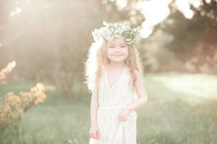 Stylish kid girl in white dress Stock Photography
