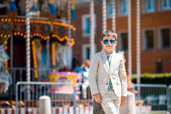 Stylish kid in a nice suit near the traditional Royalty Free Stock Photos