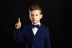 Stylish kid in suit and tie
