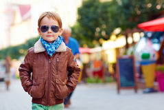 Stylish kid walking city street, autumn fashion Royalty Free Stock Photography