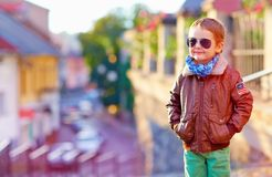 Stylish kid walking city street, autumn fashion Stock Photos