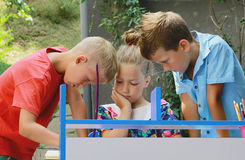 Stylish kids playing school. Outdoor photo. Education and kids fashion conc Stock Images