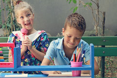 Stylish kids playing school. Outdoor photo. Education and kids fashion concept Royalty Free Stock Photo