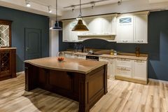 Stylish kitchen with elegant wooden counter and white cabinets royalty free stock photo