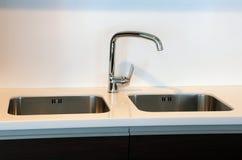 Stylish kitchen faucet Stock Photography