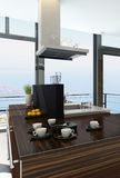 Stylish kitchen interior with cooking island and seascape view Stock Photography