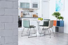 Stylish kitchen interior with dining table. And chairs stock photos