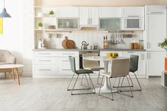 Stylish kitchen interior with dining table. And chairs royalty free stock images