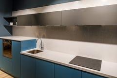 Stylish kitchen with modern style sink stock image