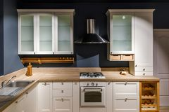 Stylish kitchen with vintage cabinets and stove stock photo