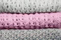 Stylish knitted pastel colored sweaters and one in sweet lilac trendy color of spring and summer 2019 folded in stack. Stylish knitted pastel colored sweaters stock image