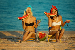 Stylish ladies at sea with watermelon Stock Images