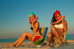 Stylish ladies at sea with watermelon Royalty Free Stock Image