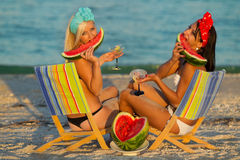 Stylish ladies at sea with watermelon Royalty Free Stock Photo