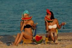 Stylish ladies at sea with watermelon stock photos
