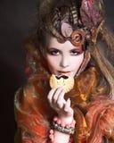 Stylish lady with cake stock photography