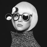 Stylish lady. Fashion studio photo of stylish lady in sunglasses Stock Photo