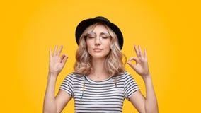 Stylish lady meditating with closed eyes stock image