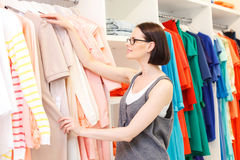 Stylish lady selecting clothing in boutique Stock Photo